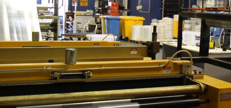 Plastic Bins, Rolls And Plastic Manufacture Machine In Workshop